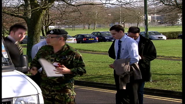 three brothers join army together; surrey: aldershot: ext macauley brothers from vehicle with mother helicopter landing one of boys kissing mother... - aldershot stock videos & royalty-free footage