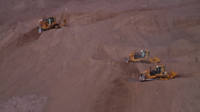 ms three bulldozers pushing sand on slope / calama, atacama desert, chile - construction vehicle stock videos & royalty-free footage