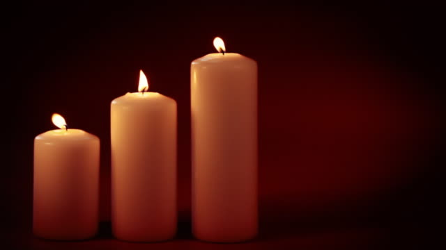 three burning candles - three objects stock videos & royalty-free footage
