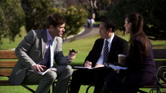 MS, Three business people having meeting in park, Sydney, Australia