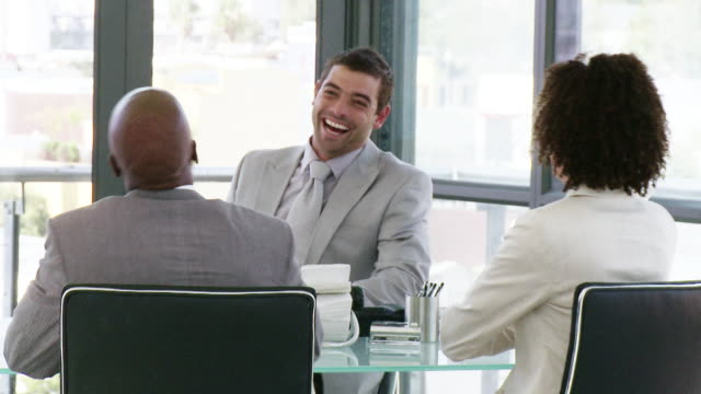 ms three business people laughing at meeting, cape town, south africa - female with group of males stock videos and b-roll footage