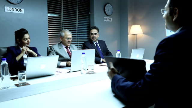 Three business people taking interview in the office, Delhi, India