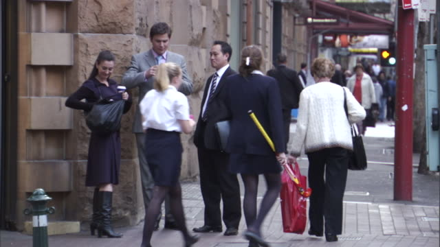 ms, three business people talking and shaking hands on busy city street, sydney, australia - pedestrian stock videos & royalty-free footage