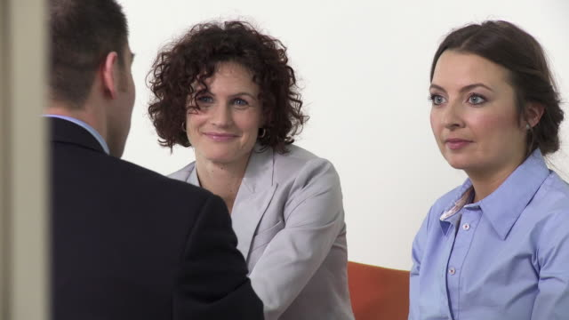 CU PAN Three business people talking at meeting in office, Copenhagen, Denmark