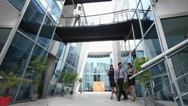three business people talking  - hemd und krawatte stock-videos und b-roll-filmmaterial