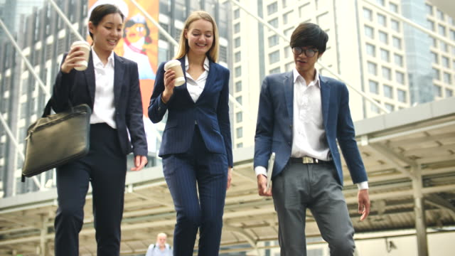 three business person walking, commuting to work - coworker stock videos & royalty-free footage