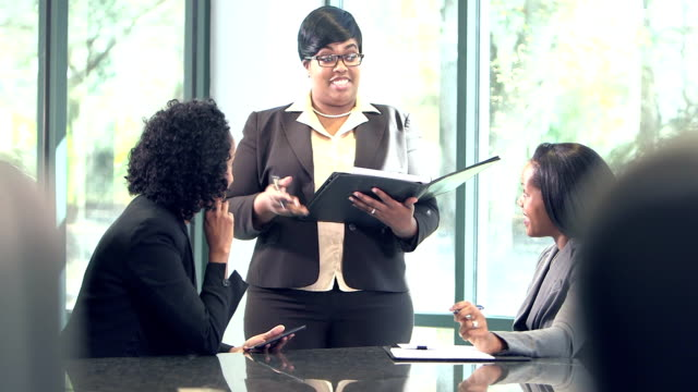 three business women conversing in board room - minority groups stock videos and b-roll footage