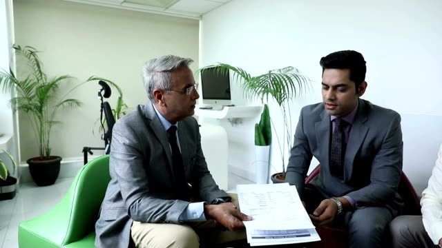 three businessmen doing meeting in the office, delhi, india - three people stock videos & royalty-free footage