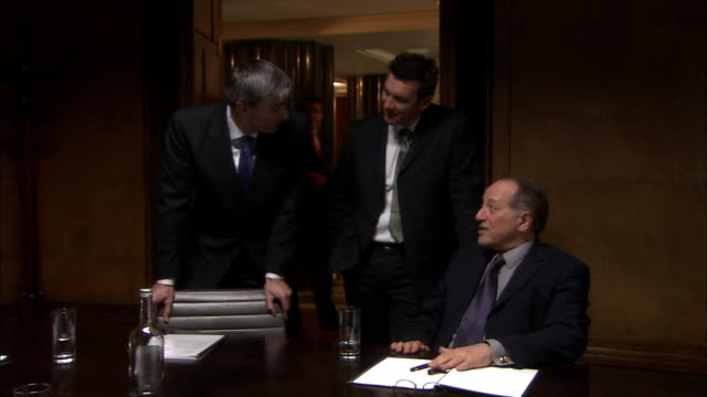 ms three businessmen talking during meeting in boardroom/ men turning and looking at camera/ london  - formal businesswear stock videos & royalty-free footage