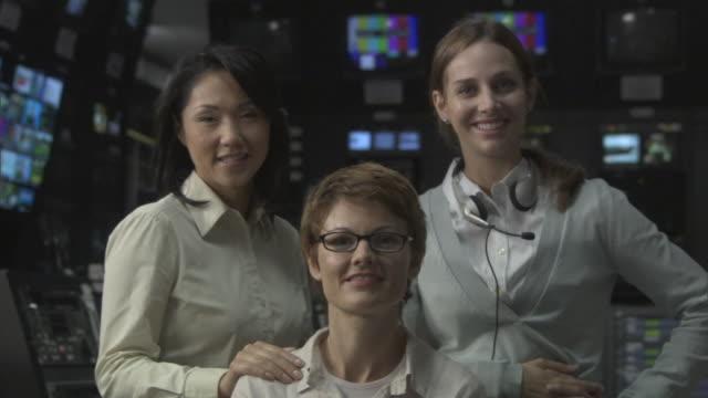 ms three businesswomen in television studio control room / culver city, california, usa - 撮影現場点の映像素材/bロール