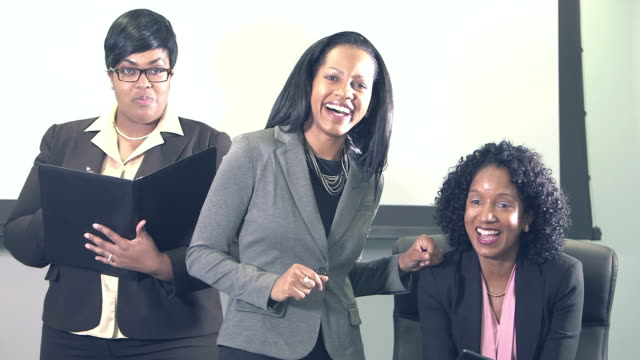 three businesswomen looking at camera making sales pitch - sales pitch stock videos & royalty-free footage