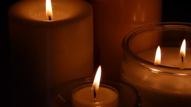 three candles burning - votive candle stock videos and b-roll footage