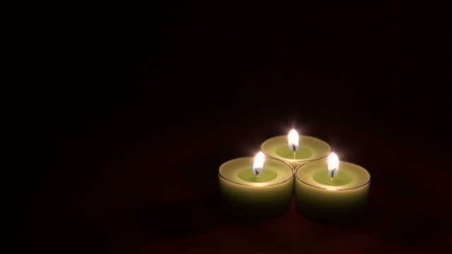 three candles in blackness - three objects stock videos & royalty-free footage