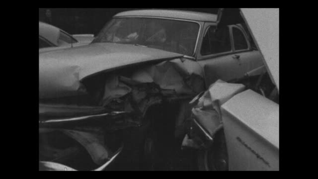 three cars had collided in a busy intersection in nashville tennessee / pontiac and cadillac crash into each other in on a road / the street traffic... - pontiac stock videos and b-roll footage