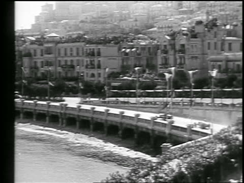 three cars racing on coastal road in monaco grand prix / monte carlo / newsreel - 1933 stock videos & royalty-free footage