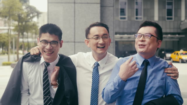 three cheerful asian businessmen having a drink after work - arm around stock videos & royalty-free footage