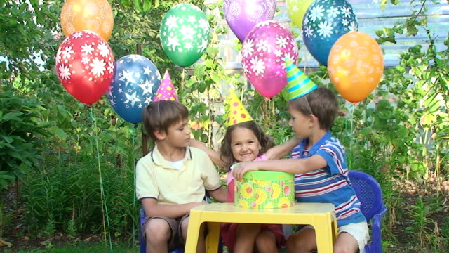 three child in party hat are happy together - party hat stock videos & royalty-free footage