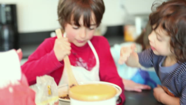 cu focusing three children (4-5, 6-7, 8-9) and girl baking, yarmouth, maine, usa - baking stock videos and b-roll footage