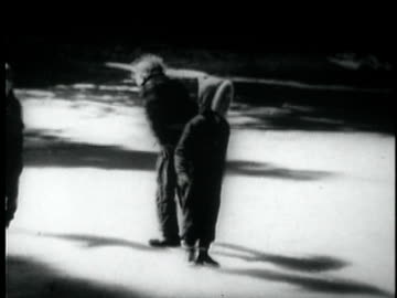 b/w ws three children dancing and falling down on slippery ice / usa - slippery stock videos & royalty-free footage
