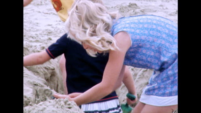 three children dig a hole on a beach; weymouth, 1975 - 1975 stock videos & royalty-free footage