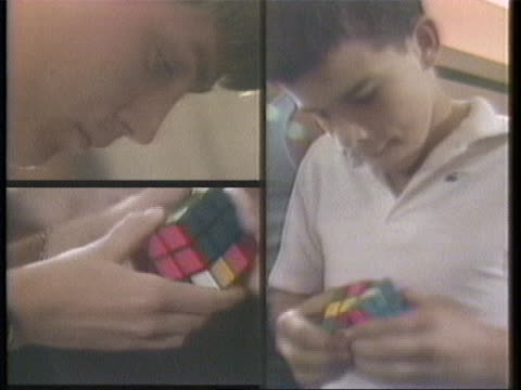 of three children each working on their rubik cube clock ticking as the children compete hands working on rubik cubes split screen of children... - clock stock videos & royalty-free footage