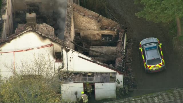 three children in hospital and number of people feared dead after house fire in powys llangammarch wells views / aerials burnout ruin of farm house... - powys stock videos & royalty-free footage
