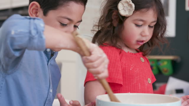 three children making cakes together in the kitchen - sister stock videos & royalty-free footage