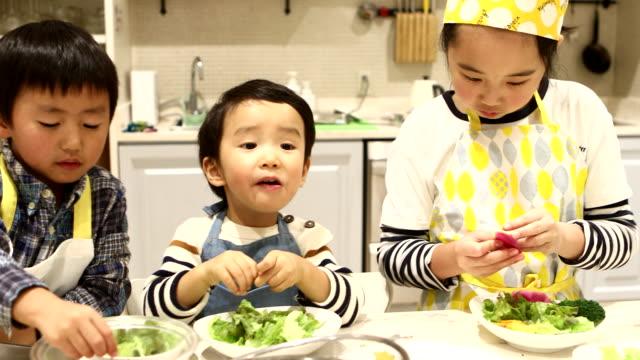 three children making salads - 8 9 years stock videos & royalty-free footage
