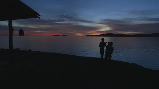 three children on beach side - weitere themen stock-videos und b-roll-filmmaterial