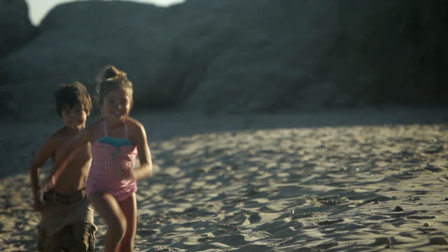 three children running on beach - brother stock videos & royalty-free footage