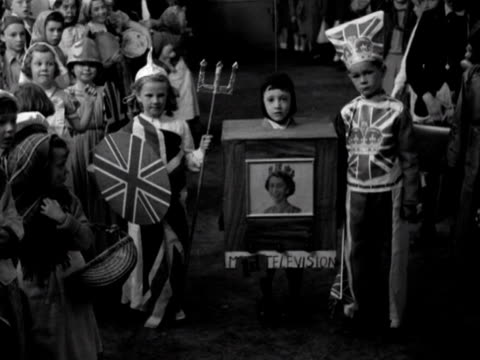 three children wear fancy dress costumes at a party to celebrate the coronation 1953 - coronation stock videos and b-roll footage