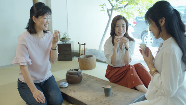 three chinese women sitting on tatami taking tea - three people stock videos & royalty-free footage