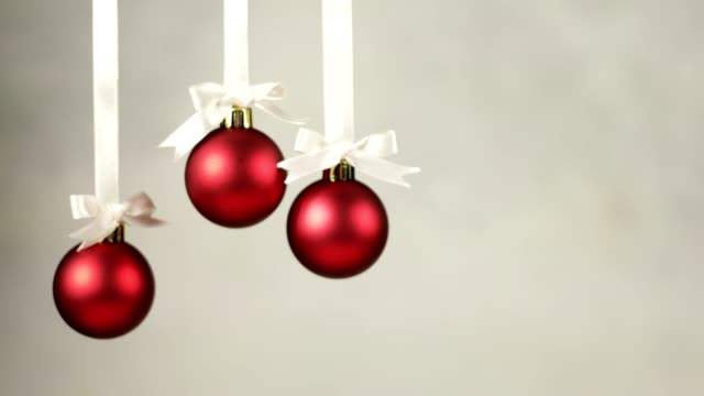 three christmas decoration balls falling one by one - string stock videos & royalty-free footage