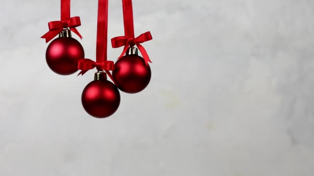 three christmas decoration balls falling one by one - hanging stock videos & royalty-free footage