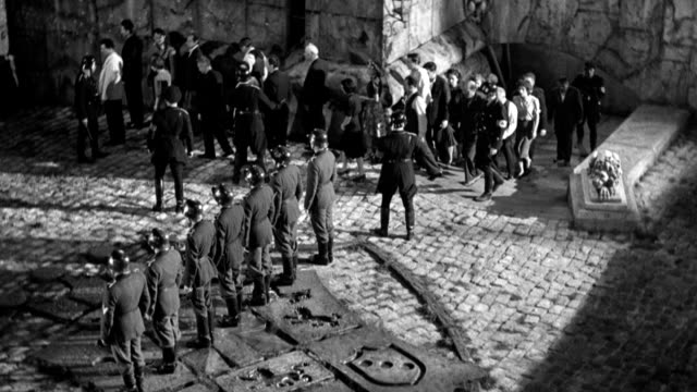 three civilian prisoners are executed in a fortress courtyard by a nazi firing squad. - civilian stock videos & royalty-free footage