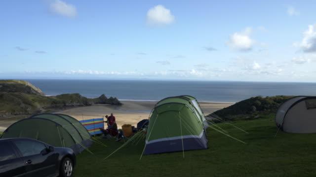 three cliffs bay holiday park, gower peninsula, wales, uk. - camping stock videos & royalty-free footage