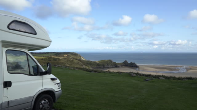 three cliffs bay holiday park, gower peninsula, wales, uk. - camper van stock videos and b-roll footage