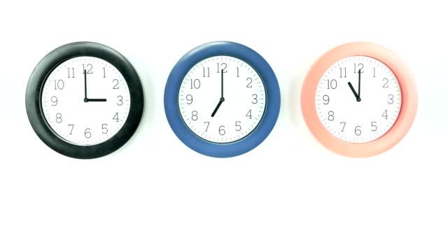 three clocks with various time