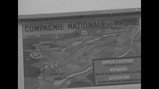 "three close ups of map on sign with words ""compagnie nationale du rhone"" on it, map showing dam system being built with aid from us marshall plan /... - rhone river stock videos & royalty-free footage"