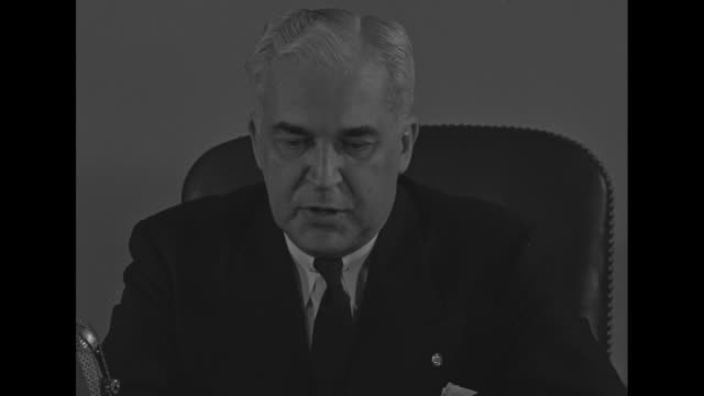 three close ups of new chairman of war manpower commission paul mcnutt sitting at desk speaking to camera - chairperson stock videos and b-roll footage