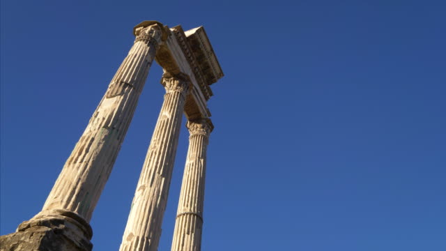 Three columns of the Temple of Castor and Pollux at the Roman Forum in Rome, Italy