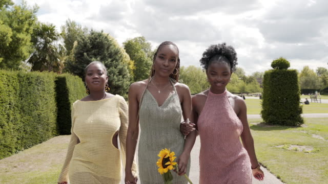 three confident young woman walking together in the park - central london video stock e b–roll