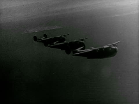 Three Consolidated PB2Y 'Coronado' patrol bomber in flight over water TD WS Aircraft carrier filled w/ planes Douglas TBD 'Devastator' monoplanes on...