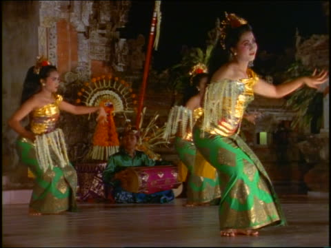 Three costumed women doing traditional Balinese dance / Hotel Sanur Beach, Bali