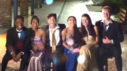 Three couples hanging out after prom