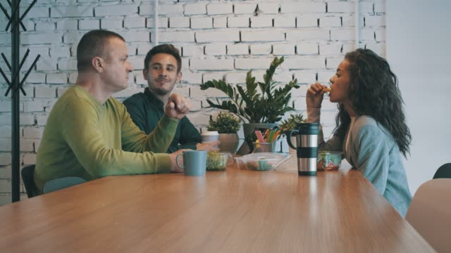 three coworkers on a lunch break together - canteen stock videos & royalty-free footage