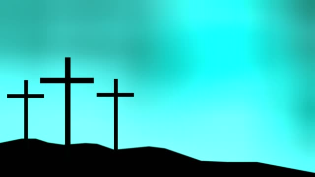 Three crosses sitting on a hill with a blue sky background