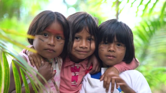 three cute children embracing and gesturing with hand - peruvian ethnicity stock videos & royalty-free footage
