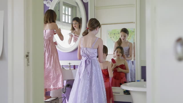 ms td pan three cute girls playing dress up and applying makeup / pasadena, california, united states   - princess stock videos & royalty-free footage
