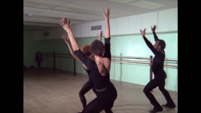three dancers in black rehearse a routine; 1974 - dance studio stock videos & royalty-free footage